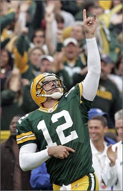 Green Bay Packers' quarterback Aaron Rodgers celebrates a 25-yard touchdown pass to Greg Jennings during the fourth quarter of their NFL football game against the Atlanta Falcons' at Lambeau Field on Sunday, Oct. 5, 2008, in Green Bay, Wis.  Atlanta won 27-24. (AP Photo/Mike Roemer)