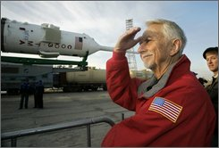 U.S. astronaut Owen Garriott looks at the Russian Soyuz TMA-13 space ship that will carry new crew members, including his son U.S. space tourist Richard Garriott, to the international space station at the launch pad in Russian leased Baikonur Cosmodrome, Kazakhstan, Friday, Oct. 10, 2008. The rocket is scheduled to blast off on Sunday, October 12.  (AP Photo/Dmitry Lovetsky)
