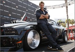 In this July 25, 2008 file photo, actor Justin Bruening poses with KITT at the Knight Rider unveiling during the 2008 Comic-Con International Convention in San Diego. The talking car known as KITT, originally a Pontiac Trans Am in the 1980s series, returned to TV this fall as part of a new version of the show on NBC, but this time in the form of a Ford Shelby Mustang.  (AP Images/Mark Davis, file)