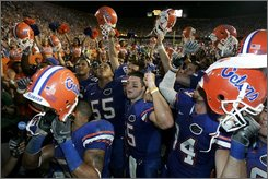 Florida players celebrate in front of fans after defeating LSU 51-21, in an NCAA college football game in Gainesville, Fla., Saturday, Oct. 11, 2008.  (AP Photo/John Raoux)