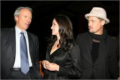 "In this photo provided by Starpix, Clint Eastwood, left, Angelina Jolie and Brad Pitt talk during a screening of ""Changeling"" in New York, Saturday, Oct. 4, 2008. (AP Photo/Starpix, Dave Allocca)"
