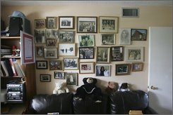 """Family photographs hang on the wall of Herman and Roma Rosenblat's North Miami Beach, Fla. home, Sept. 25, 2008 .  Laurie Friedman wrote a book, """"Angel Girl,"""" about the beginning of Herman's relationship with Roma during the Holocaust. (AP Photo/J. Pat Carter)"""
