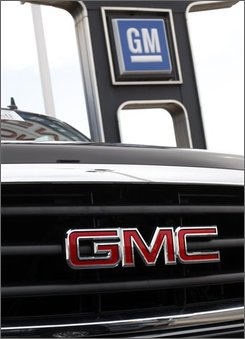 In this Aug. 17, 2008 file photo, an unsold 2008 Sierra pickup truck sits under the sign at a GMC Truck dealership in the south Denver suburb of Littleton, Colo. General Motors Corp. shares on Thursday, Oct. 9, 2008, plunged to their lowest level since the opening months of the Korean War, as investors continued to fret that the decline in U.S. vehicle sales may be spreading to the rest of the world.  (AP Photo/David Zalubowski, file)