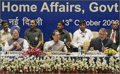 Indian Prime Minister Manmohan Singh, left, United Progressive Alliance chairperson Sonia Gandhi, center, and Home Minister Shivraj Patil, right, take part in the 14th National Integration Council meeting, in New Delhi, India, Monday, Oct. 13, 2008.  (AP Photo)