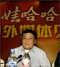 In this July 3, 2007, file photo, Zong Qinghou, chairman of Wahaha Group, listens questions from journalists during a press conference in Hangzhou, China. Chinese beverage maker Wahaha Group is considering buying dairy assets from Sanlu Group, the milk maker at the heart of a scandal over milk tainted with an industrial chemical, reports said Monday October 13, 2008.  Wahaha spokesman Shan Qining said he could not confirm the reports citing the company's chairman, Zong Qinghou, as saying he wants to buy a milk powder production line from Sanlu. (AP Photo/Eugene Hoshiko, FILE)