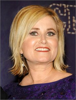 In this April 14, 2008 file photo, actress Maureen McCormick poses in the press room at the 2008 CMT Awards in Nashville, Tenn. (AP Photo/Evan Agostini, file)