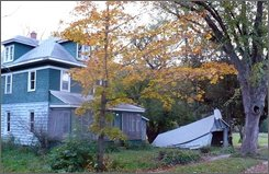 A vacant home is seen in Gays Mills, Wis., on Tuesday, Oct. 7, 2008. Officials estimate as many as 50 homes like this one may still be vacant following two floods in 10 months. Dozens of residents still haven't returned, leaving behind deserted neighborhoods, ruined homes and village leaders fighting to keep their hometown from going under for good. (AP Photo/Todd Richmond)