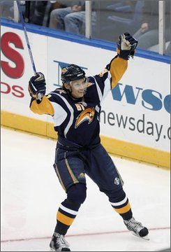 Buffalo Sabres' Maxim Afinogenov, of Russia, celebrates a goal by Adam Mair during the second period of an NHL hockey game against the New York Islanders on Monday, Oct. 13, 2008, at Nassau Coliseum in Uniondale, N.Y. (AP Photo/Seth Wenig)