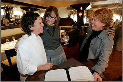From left, chef and co-owner Traci Des Jardins goes over a menu for a wedding reception with Chloe Harris and Frankie Frankeny at Jardiniere restaurant in San Francisco, Thursday, Oct. 2, 2008. Gay couples from across California and the nation are feverishly planning to tie the knot before Election Day to avoid possible passage of a California ballot initiative aimed at banning same-sex marriage. (AP Photo/Marcio Jose Sanchez)