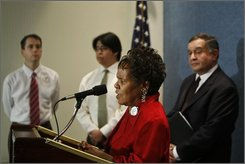 Maryland ACORN president, Rev. Gloria Swierenga speaks at a press conference in Washington, Tuesday, Oct. 14, 2008. Behind her is ACORN spokesperson Kevin Whelan, left, newly  registered voter Enrique Peralta, and  Miles Rapoport, former Connecticut Secretary of State and president of Demos. (AP Photo/Gerald Herbert)