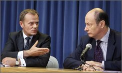 Polish Prime Minister Donald Tusk, left, seen with Finance Minister Jacek Rostowski, right, during a news conference in Warsaw, Poland, Monday, Oct. 13, 2008. Tusk said the world financial crisis highlights the need for his country to accelerate its efforts to adopt the EU's common currency. ( AP Photo/Czarek Sokolowski)