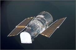 The Hubble Space Telescope is backdropped against black space as the Space Shuttle Columbia, with a crew of seven astronauts on board approached in this March 3, 2002 file photo. NASA engineers said  they know how to fix the broken Hubble Space Telescope