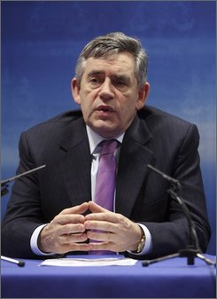 British Prime Minister Gordon Brown speaks during a media conference at an EU summit in Brussels, Wednesday Oct. 15, 2008. Efforts to calm the impact of the global financial crisis will top the agenda at a two-day EU leaders summit along with talks on how the 27-nation bloc can keep on track ambitious promises to cut greenhouse gas emissions by 20 percent by 2020. (AP Photo/Geert Vanden Wijngaert)