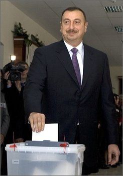 Azerbaijan President Ilham Aliev casts his vote at a polling station in Baku, Azerbaijan, Wednesday Oct. 15, 2008. President Ilham Aliyev is poised to sweep to victory in his bid for a second term as the leader of this oil-rich country, located in the strategically critical Caucasus mountains region. (AP Photo/Mikhail Metzel)
