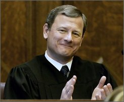 "In this Feb. 12, 2008, file photo U.S. Supreme Court Chief Justice John G. Roberts, Jr., applauds after the singing of ""America The Beautiful""a speaker at the opening celebration of the Centennial of the U.S. Courthouse in Providence, R.I.   After three years on the job as chief justice what is Roberts' reputation? Incisive questioner. Good writer. Fast. Funny. (AP Photo/Stephan Savoia, File)"