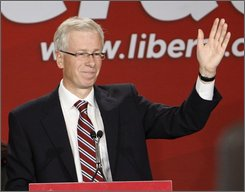 Liberal Leader Stephane Dion takes to the stage after losing the federal election Tuesday Oct.14, 2008 in Montreal, Quebec.  (AP Photo/THE CANADIAN PRESS/Fred Chartrand)