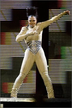 "Janet Jackson performs in the first concert of her ""Rock Witchu"" tour since her recent illness, in Washington on Wednesday, Oct. 15, 2008. (AP Photo/Jacquelyn Martin)"