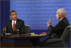 Democratic presidential candidate Sen. Barack Obama, D-Ill., and Republican presidential candidate Sen. John McCain, R-Ariz., talk during the presidential debate Wednesday, Oct. 15, 2008, at Hofstra University in Hempstead, N.Y. (AP Photo/Gary Hershorn, Pool)