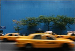 Traffic passes a boarded up store window display on New York's Fifth Avenue Thursday, Oct. 16, 2008 in New York. (AP Photo/Mark Lennihan)