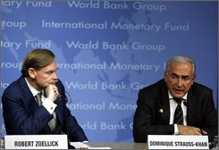 In this Oct. 12, 2008 file photo, International Monetary Fund Managing Director Dominique Strauss-Kahn, right, and World Bank President Robert B. Zoellick speak during a news conference at IMF headquarters in Washington Sunday, Oct. 12, 2008. Seeking a greater role for his 185-nation organization, Dominique Strauss-Kahn, the ambitious French leader of the IMF, has enthusiastically embraced a mandate to use its resources and skills to play a central role in the global economy.  (AP Photo/Jose Luis Magana)