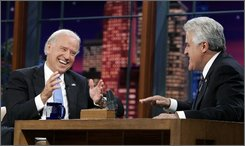 "Host Jay Leno, right, and  Democratic vice-presidential candidate Joe Biden chat during a taping of ""The Tonight Show With Jay Leno"" at NBC Studios in Burbank, Calif., Thursday, Oct. 16, 2008.  (AP Photo/Reed Saxon)"