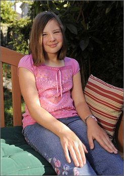 Isabel Loeffler, 12, poses in the backyard of her home, Thursday, Oct. 16, 2008, in the Calabasas section of Los Angeles. After failing to finish a reading assignment, Isabel Loeffler was sent to the school's time-out room, a converted storage area under a staircase, where she was left alone for three hours. Some educators say time-out rooms are being used with increased frequency to discipline children with behavioral disorders.  (AP Photo/Mark J. Terrill)