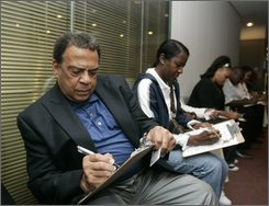 Civil-rights leader, former Atlanta Mayor and U.N. Ambassador Andrew Young fills out paperwork as he waits in line to cast his ballot early at the Fulton County Government Center in Atlanta Wednesday, Oct. 16, 2008. Four decades after the end of  legalized segregation, civil rights icon Andrew Young was prepared to do what he could not have imagined was possible in his lifetime