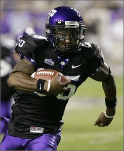 TCU wide receiver Jeremy Kerley runs for a gain in the first half of an NCAA college football game against BYU in Fort Worth, Texas, Thursday, Oct. 16, 2008. (AP Photo/Donna McWilliam)