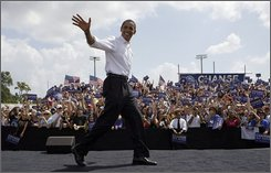 In this Wednesday, Sept. 24, 2008 file photo, Democratic presidential candidate Sen. Barack Obama, D-Ill., speaks during a rally in Dunedin, Fla.. Obama poured millions of dollars into Florida over the summer but couldn't close in on John McCain's comfortable lead. Now, the coveted state with 27 electoral votes is a tossup. (AP Photo/Chris Carlson)