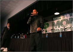 "In this photo provided by JLM PR, Ludacris, right, speaks at ""Get Your House Right"" panel discussion at Clark Atlanta University on Friday, Oct. 17, 2008. Moderator and Hip-Hop Summit Action Network president Dr. Benjamin is seen at left. With the housing market in a slump, foreclosures on the rise and lenders keeping a tighter grip on mortgage money, about 2,000 interested consumers turned out Friday night to get real estate advice from ... music stars. (AP Photo/JLM PR, Johnny Nunez)"