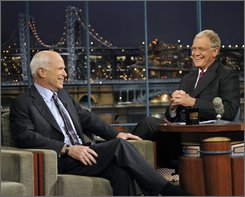 "In this photo released by CBS, Republican Presidential candidate Sen. John McCain, left, talks with host David Letterman on the set of ""The Late Show with David Letterman,"" Thursday, Oct. 16, 2008 in New York. (AP Photo/CBS, J.P. Filo)"