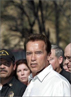 Gov. Arnold Schwarzenegger, joined by state and local officials, talks to reporters after viewing the Twin Lakes area of Los Angeles County that burned in the Sesnon Fire, Thursday, Oct. 16, 2008.  (AP Photo/Reed Saxon, Pool)