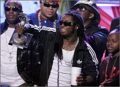 Lil Wayne, center, accepts the MVP of the Year award during the BET Hip Hop Awards '08, Saturday Oct. 18, 2008, in Atlanta. (AP Photo/John Amis)