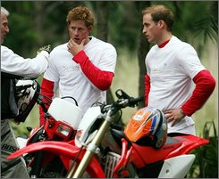 Britain's Prince William, right, and his brother Harry, left, are seen with their motorcycles in Port Edward, South Africa, Friday, Oct. 17, 2008, on the eve of their charity motorcycle ride. The off-road motorcycle ride will raise money for UNICEF, the Nelson Mandela Children's Fund and Sentebale, a charity founded in 2006 by Prince Harry and Lesotho's Prince Seeiso, for projects in South Africa and Lesotho. (AP Photo/Jon Hrusa, POOL)