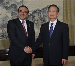 Pakistan's President Asif Ali Zardari, left, shakes hands with Chinese Premier Wen Jiabao at the Zhongnanghai leaders compound in Beijing on Thursday October 16, 2008. Pakistan's president met with China's premier on Thursday, a day after clinching agreements aimed at boosting Chinese involvement in his country's ailing economy.  (AP Photo/Kota Kyogoku, POOL)