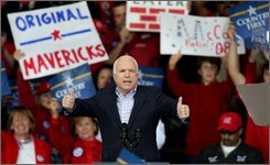 Republican presidential candidate Sen. John McCain, R-Ariz., gestures at a rally in Woodbridge, Va., Saturday, Oct. 18, 2008. (AP Photo/Luis M. Alvarez)