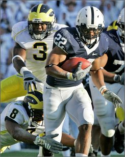 Penn State running back Evan Royster (22) rushes for a 24-yard touchdown in the first quarter against Michigan during an NCAA college football game in State College, Pa., Saturday, Oct. 18, 2008. (AP Photo/Gene J. Puskar)