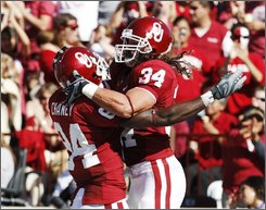 Oklahoma fullback Matt Clapp (34) and wide receiver Quentin Chaney (84) celebrate following Clapp's touchdown in the first quarter of an NCAA college football game against Kansas in Norman, Okla., Saturday, Oct. 18, 2008. (AP Photo/Sue Ogrocki)