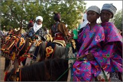 Children learn to ride horses at the Durbar ceremony in Kano, northern Nigeria, on Tuesday, Sept. 30, 2008. The annual durbar ceremony in Kano is a reenactment of an Islamic jihad that swept the region two decades ago, and the emirs are considered descendants of the jihadi leaders. (AP Photo/Edward Harris)
