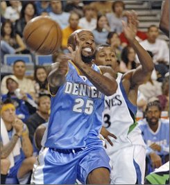 Denver Nuggets' Anthony Carter moves the ball inside past Minnesota Timberwolves' Sebastian Telfair during the first half of an NBA basketball game Sunday, Oct. 19, 2008, in Bismarck, N.D. (AP Photo/Tom Stromme)