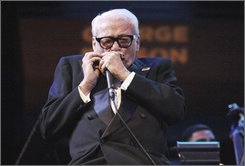 In this photo provided by the National Endowment for the Arts, Belgian-born Toots Thielemans performs at the Rose Theater in New York, Friday, Oct. 17, 2008. Thielemans was honored by the National Endowment for the Arts as one of its 2009 Jazz Masters. (AP Photo/National Endowment for the Arts, Tom Pich)