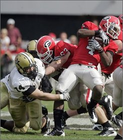 Georgia running back Caleb King (4) breaks away from Vanderbilt's T.J. Greenstone (74) during the fourth quarter of an NCAA college  football game in Athens, Ga.,  Saturday, Oct. 18,  2008. Georgia won 24-14. (AP Photo/John Bazemore)