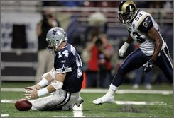 Dallas Cowboys quarterback Brad Johnson, left, falls on a fumbled snap as St. Louis Rams linebacker Quinton Culberson defends during the first quarter of an NFL football game Sunday, Oct. 19, 2008, in St. Louis. Dallas retained possession of the ball. (AP Photo/Jeff Roberson)