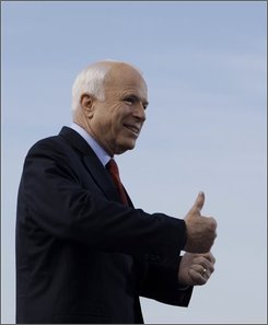 Republican presidential candidate Sen. John McCain, R-Ariz. gives the thumbs up before speaking at a rally in St. Charles, Mo., Monday, Oct. 20, 2008. (AP Photo/Carolyn Kaster)