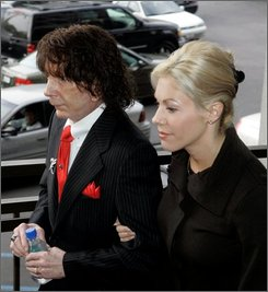 Music producer Phil Spector, left, and his wife Rachelle Spector arrive at Los Angeles County Superior Court Monday, Oct. 20, 2008, for the start of jury selection in his murder re-trial. Spector is charged with second-degree murder in the 2003 death of actress Lana Clarkson, 40, at his Alhambra mansion. (AP Photo/Nick Ut)