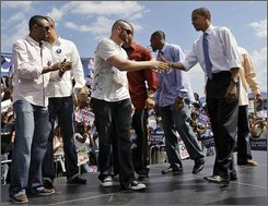 Democratic presidential candidate Sen. Barack Obama, D-Ill., right, shakes hands with members of the World Series-bound Tampa Bay Rays baseball team, Monday, Oct. 20,2008, during a rally at Legends Field in Tampa, Fla. (AP Photo/Alex Brandon)