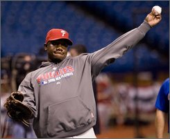 Philadelphia Phillies first baseman Ryan Howard throws during the team's practice at Tropicana Field in St. Petersburg, Fla., Monday, Oct. 20, 2008. The Philadelphia Phillies will meet the Tampa Bay Rays in Game 1 of the World Series on Wednesday, Oct. 22. (AP Photo/Steve Nesius)