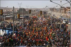 Supporters of Bolivia's President Evo Morales march towards La Paz  in El Alto, Monday, Oct. 20, 2008. Protesters marched to demand Congress call a referendum on President Morales' proposed constitution. Morales attended the demonstration. (AP Photo/Dado Galdieri)
