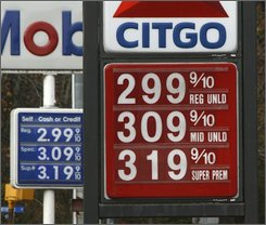 Gas prices have dropped below $3 a gallon in Montpelier, Vt., Monday, Oct. 20, 2008. Consumers got another break at the gas pump Monday, as prices dropped further below $3 a gallon and approached year-ago levels even as the near-certainty of an OPEC production cut pushed oil prices marginally higher. (AP Photo/Toby Talbot)