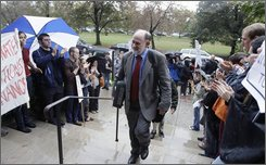"Bruce Lincoln, center, a religion professor at the University of Chicago enters a campus building Wednesday, Oct. 15, 2008, to discuss the issue of naming a new institute after the late Nobel prize winning economist Milton Friedman who taught at the university for 30 years . Lincoln, who has led protests, opposes the naming of a new institute after Friedman. ""The current crisis dramatizes the limitations of his positions. His time was important, but it's past,""  Lincoln said. (AP Photo/M. Spencer Green)"